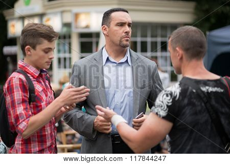 RUSSIA, MOSCOW - 30 JUL, 2015: Actor Alexander Nevsky standing in the Sokolniki park at shooting movie (Maximum shock).