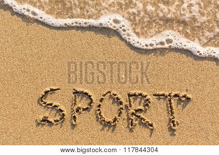 Sport - inscription on sand beach with the soft wave.