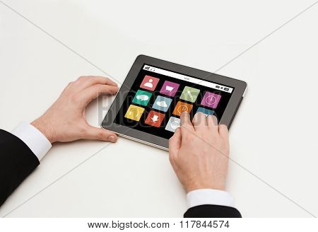 business, internet, people and technology concept - close up of man hands working with with application icons tablet pc computer screen