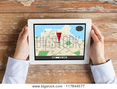 navigation, location, people and technology concept - close up of female hands with gps navigator map on tablet pc computer screen
