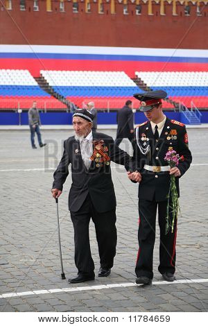 Young Soldier Helps Old Veteran To Walk On Rehearsal Of Parade