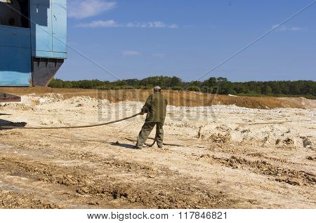 Worker Dragging Electric Cabling