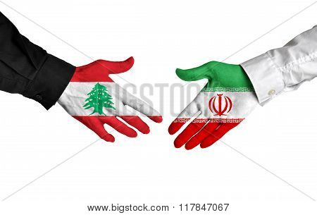 Lebanon and Iran leaders shaking hands on a deal agreement