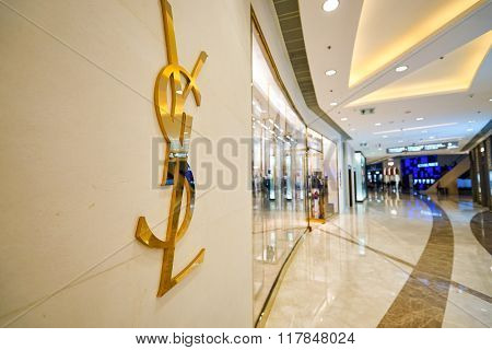 HONG KONG - JANUARY 27, 2016: Yves Saint Laurent logo on the wall at Elements Shopping Mall. Elements is a large shopping mall located on 1 Austin Road West, Tsim Sha Tsui, Kowloon, Hong Kong