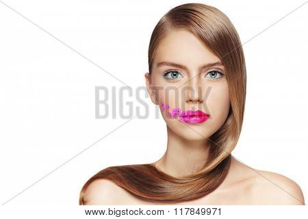 Portrait of young beautiful girl with fuchsia lipstick and small pink flowers on her face over white background, copy space