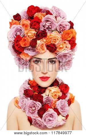 Young beautiful woman in fancy wig of colorful roses over white background