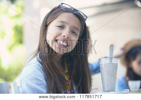 Portrait of lovely girl smiling at workplace