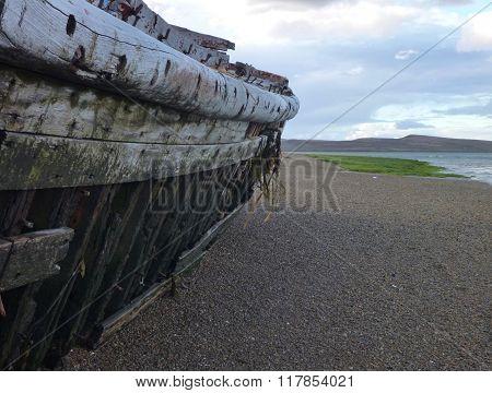 Boat Wreck At A Lake Shore