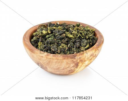 oolong green tea heap in bowl, isolated on white