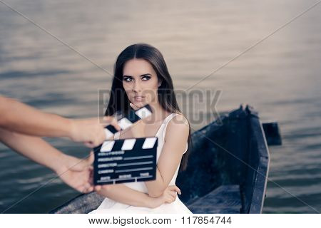 Retro Actress Shooting Movie Scene in a Boat