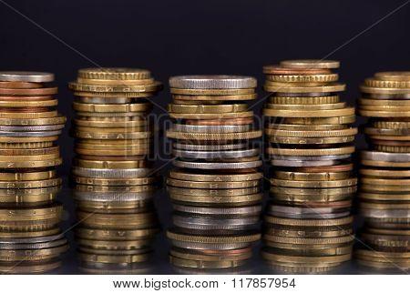 Stack Coins Over Black Background