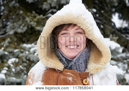 Woman portrait at winter season with snow on head