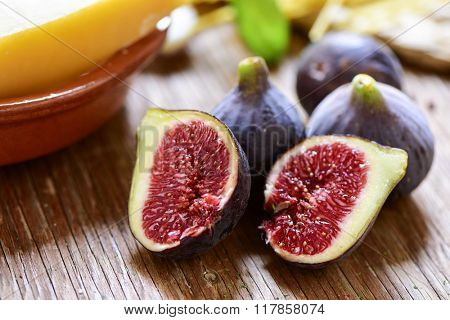 closeup of some ripe figs on a rustic wooden surface