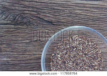 Rice on dark wooden table