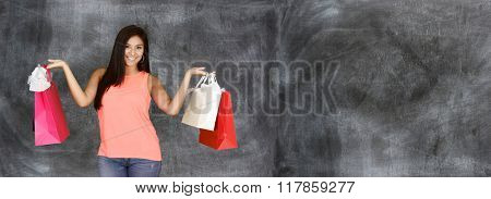 Woman holding her shopping bags from the mall