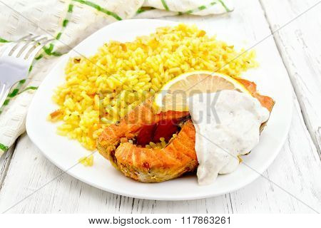 Salmon with lemon and rice on board