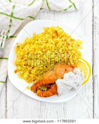 Salmon with rice on board top