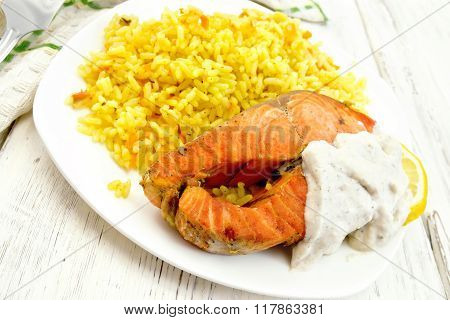 Salmon with rice on light board
