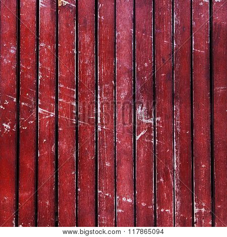 Red Wooden Timber / Scuffed Planks Background Texture.