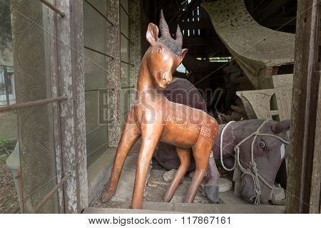 Wooden Statue Of Animals. Suaya Is Cliffs Old Burial Site In Tana Toraja. South Sulawesi, Indonesia