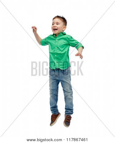 happiness, childhood, freedom, movement and people concept - happy little boy jumping in air