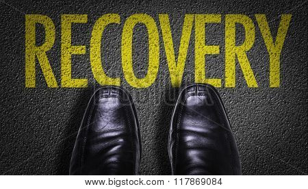 Top View of Business Shoes on the floor with the text: Recovery