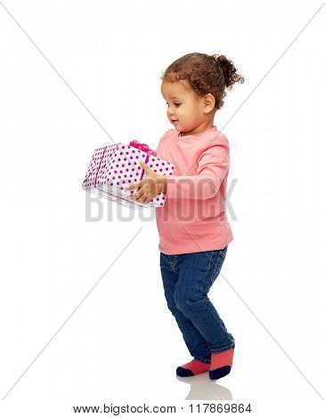 childhood, fashion, birthday, holidays and people concept - beautiful little african american baby girl walking with gift box