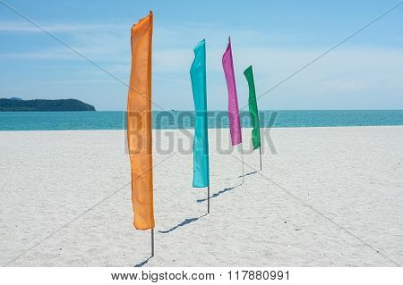 Colorful flags in tropical beach on afternoon.