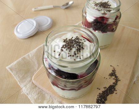 Trifle dessert with strained yogurt, berries and chia seeds
