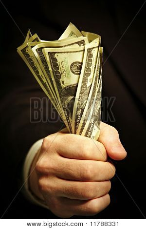 Man's Hand Holds Dollars