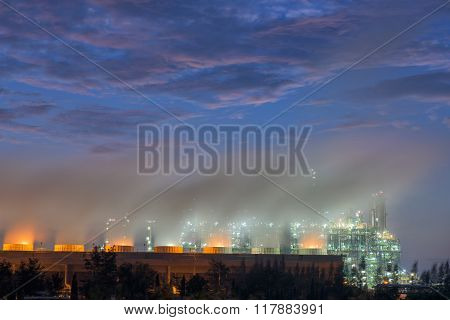 Steaming Cooling Tower Of Oil Refinery Plant, Twilight Shot.