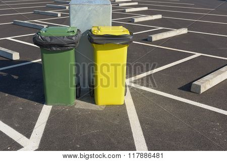 Garbage Cans Beside Of The Car Parking.
