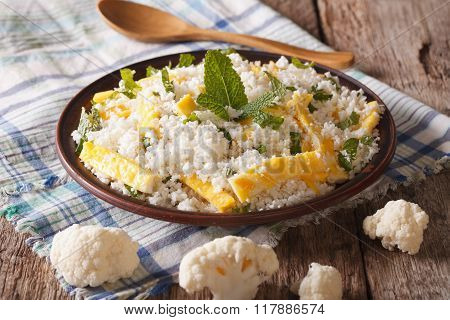 Dietary Food: Cauliflower Rice With Scrambled Eggs. Horizontal