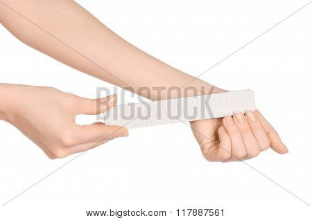 Health And Hand Care Topic: A Woman's Hand Holding A Nail File For Manicure Isolated On White Backgr