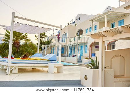 SANTORINI, GREECE - AUGUST 05, 2015: view of Andromeda Villas at morning. Andromeda Villas is an elegant hotel are situated in Imerovigli, Santorini island.