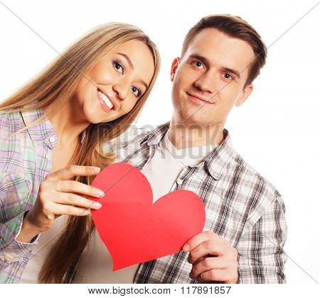 Happy couple in love holding red heart