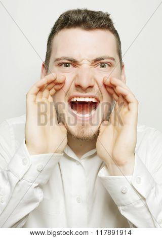 businessman in white shirt  shouting