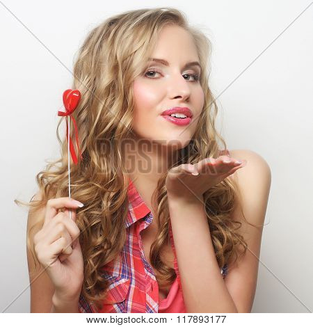 young happy blond woman with little red heart