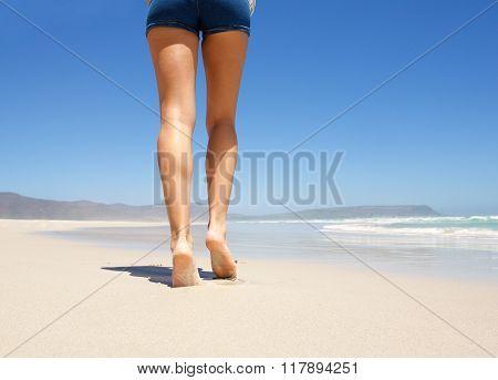 Legs Walking Barefoot On Beach