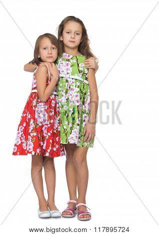 Girls sisters hugging