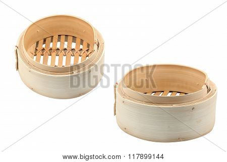 Bamboo steamer for dim sum isolated on white