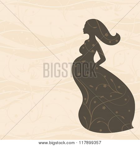 Pregnant woman in long dress with long hair on beige background