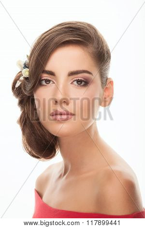 Closeup portrait of young romantic brunette woman with flower headpiece and cute makeup in read blou