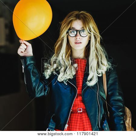 young hipster woman with balloon in the city