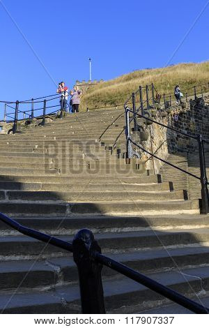 Whitby North Yorkshire UK 11th September 2015: A view from the 199 steps Man taking photo .