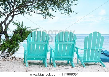 Turquoise beach chairs - Stock image.