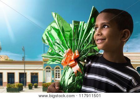 Happy Brazilian boy showing Easter Egg