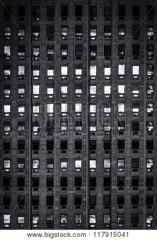 exterior blue light on windows on a hight office building