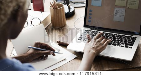 African Woman Working Design Notepad Concept