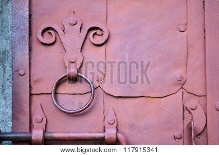 Industrial Textured Background - Old Dark Pink Door With Rivets And Aged Metal Door Handle In The Fo